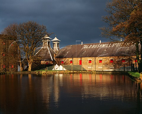 Pagodas and warehouse of the Old Bushmills   Distillery viewed over the dammed StColumbs Rill source of the water for the whiskey production   Bushmills Co Antrim Northern Ireland