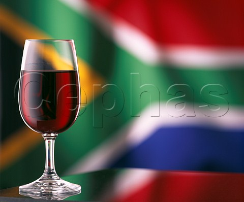 Glass of red wine and South Africa flag
