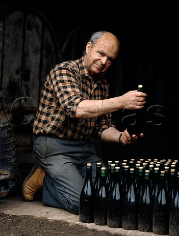 Paul Chanu examines his newly bottled Brut Cider as it undergoes its final fermentation in bottle   StMartindeSallen Normandy France