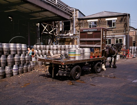 Brewers dray being unloaded and barrels decorked at Youngs Ram Brewery Wandsworth London