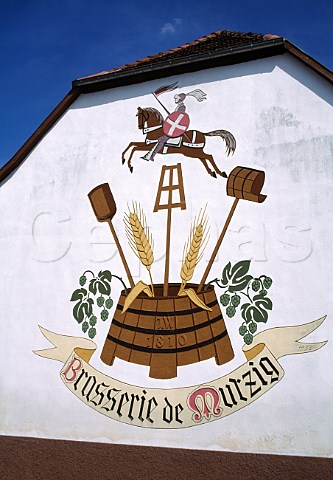 Mural on one of the older brewery   buildings in Mutzig BasRhin France   Alsace
