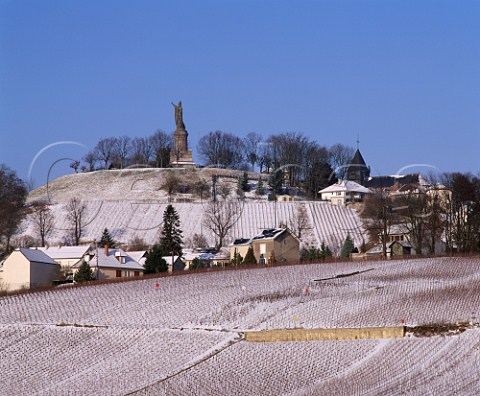 ChatillonsurMarne and its snow covered vineyards  in the Marne valley overlooked by the huge statue of  Pope Urbain II   Marne France     Champagne  Marne la Valle