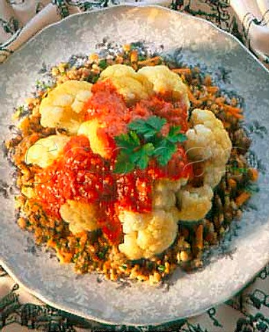 Cauliflower with tomato sauce on a bed of cooked   wheat