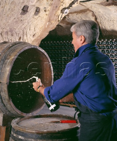 Jacques Pters now retired disgorging a bottle of 1953 Champagne Veuve Clicquot Ponsardin   Reims Marne France