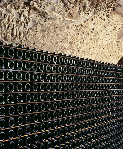Bottles of La Grande Dame lying sur lattes in the cellars of Veuve Clicquot Ponsardin in the GalloRoman chalk quarries crayres of Reims Marne France  Champagne