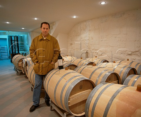 JeanLuc Thunevin with new oak barriques holding   wine undergoing the malolactic fermentation  Chteau   de Valandraud Stmilion Gironde France