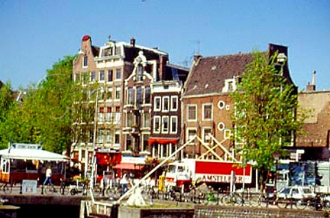Sluis or lock with herring stall beer   lorry and old gabled houses Amsterdam     Netherlands