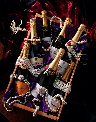 Bottles of Champagne with pearls Albert Etienne   Bollinger Veuve Clicquot Ponsardin and Taittinger