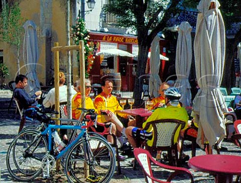 Cyclists drinking beer at terrace tables of a   caf  bar in the market square Chinon   IndreetLoire France  Touraine