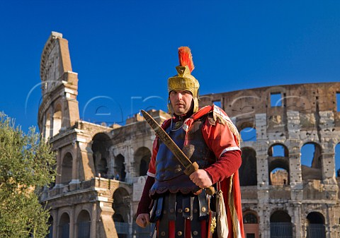 Roman soldier posing for tourists outside the Colosseum Rome Italy