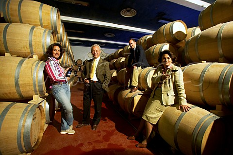 Jos Giaccomo Antonio and Gabriella Anca Rallo in the Mille e una Notte barrel cellar of Donnafugata Winery Marsala Sicily Italy