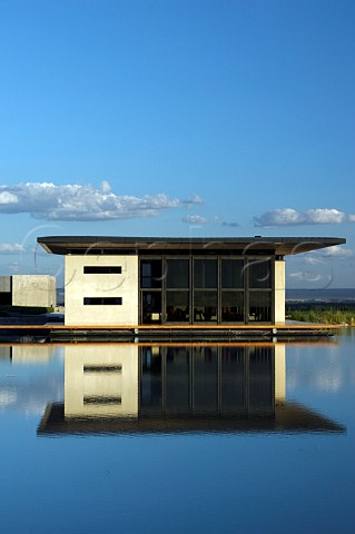 Restaurant of Bodega OFournier with reflection in irrigation lake  Uco Valley Mendoza Argentina