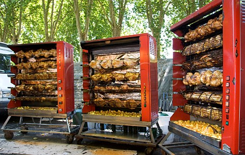 Rotisserie chickens in market at Amboise IndreetLoire France