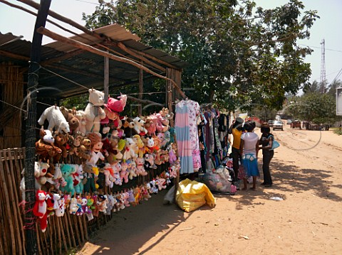Roadside stall selling childrens soft toys and womens clothes Ponta do Ouro southern Mozambique