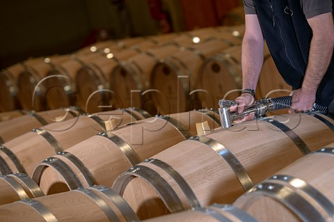 Cyril Meyrou filling new oak barriques in the cellar of Chteau Richelieu Fronsac Gironde France   Fronsac  Bordeaux